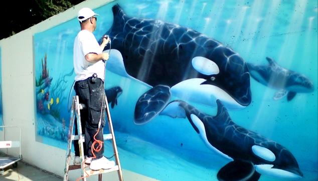 הלל לזרוב מצייר דולפינים