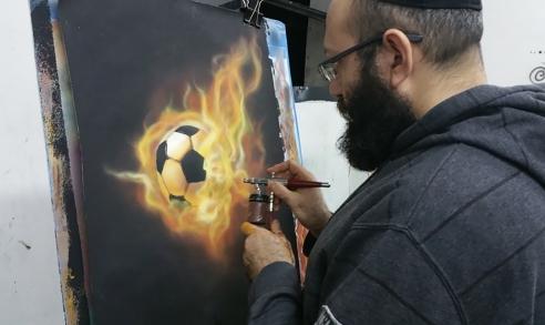 ציור של כדורגל עולה באש